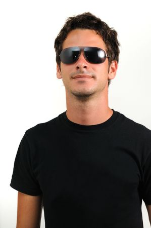 Portrait of young trendy man wearing sunglasses isolated Stock Photo
