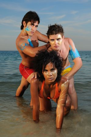 bodypaint: Portrait of young diverse group of friends on the beach Stock Photo