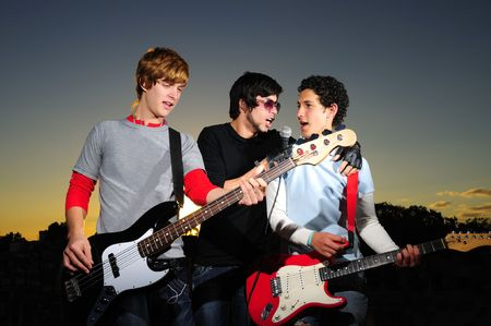 Portrait of three trendy teenagers playing music outdoors Stock Photo - 3686671