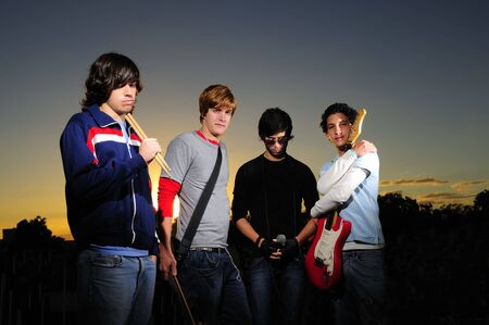 Portrait of young trendy musicians group posing Stock Photo - 3686641