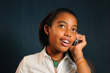 Portrait of young trendy african girl using a cell phone photo