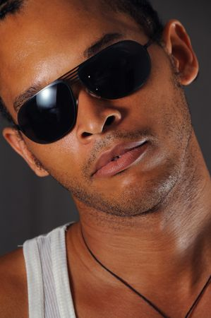 Portrait of young trendy african man with sunglasses photo