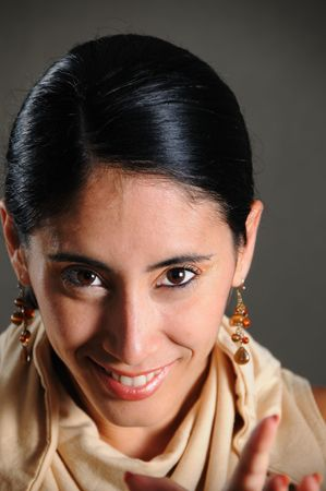 Portrait of young beautiful hispanic woman with happy expression photo