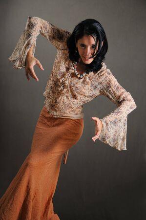 Portrait of young trendy hispanic woman posing in flamenco pose photo