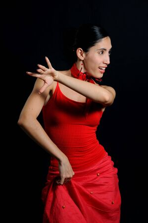 Portrait of passionate flamenco dancer isolated on black 스톡 콘텐츠