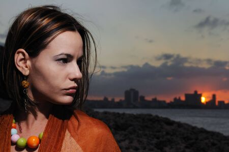 Portrait of young beauty against sunset background - havana skyline  photo