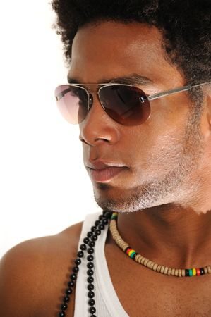 Portrait of young trendy african american man posing with sunglasses photo
