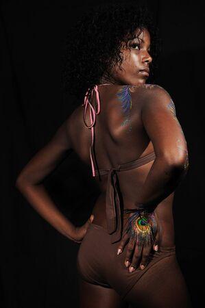 Portrait of young fashion woman wearing bikini isolated photo
