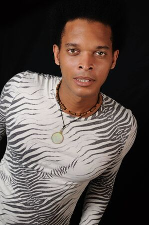 Portrait of young trendy african male model with attitude photo