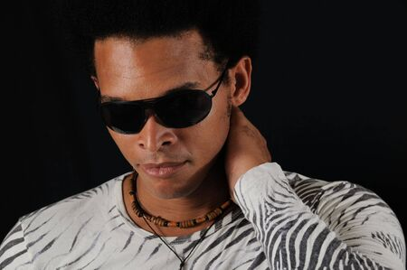 Portrait of young trendy african american man wearing sunglasses photo