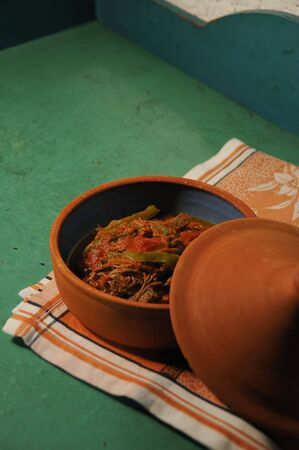 typical: Detail of typical cuban dish over green surface