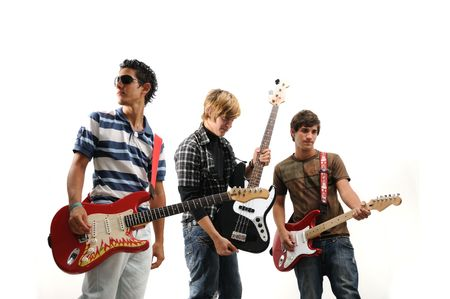 a guitarist boy playing guitar: Trendy group of teenagers with musical instruments - isolated Stock Photo