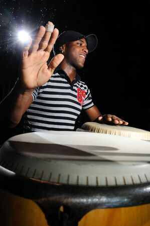 percussionist: Portrait of young cuban percussionist performing live