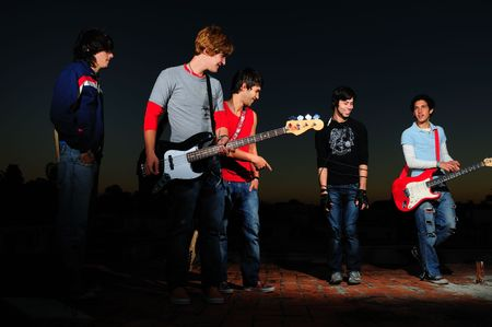 Portrait of a group of young musicians with instruments photo
