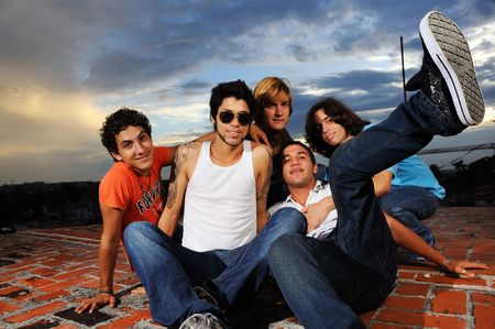 Portrait of young trendy group of male friends having fun photo