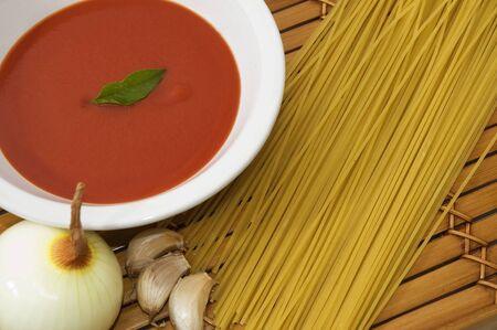 Pasta ingredients background with tomato sauce photo