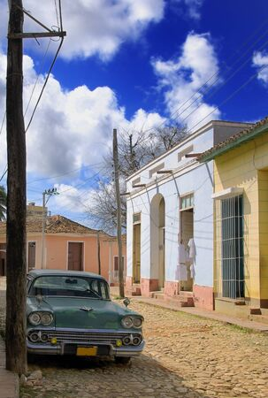 A view of Trinidad town, typical facades and oldtimer photo