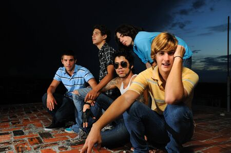 Portrait of young trendy group of male friends standing with attitude Stock Photo - 4012090