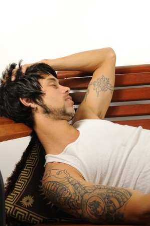 Portrait of a young hispanic man taking a nap - isolated over white Stock Photo
