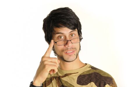 reflexive: Portrait of a young hispanic man wearing reading glasses - isolated over white Stock Photo
