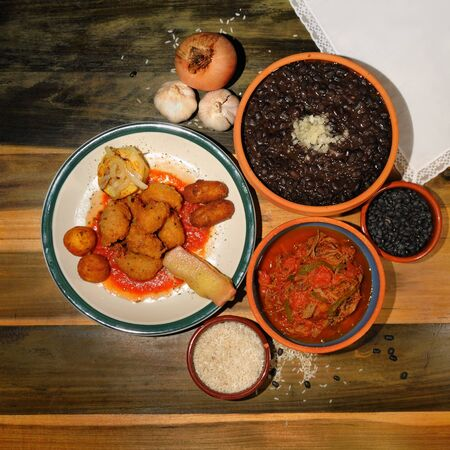 typical: Assorted typical cuban dishes over wooded table Stock Photo