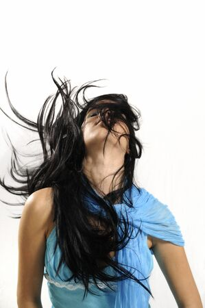 Portrait of young hispanic beauty waving her hair - isolated Stock Photo - 4142671