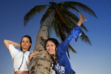 Portrait of two happy young women enjoying the summer breeze