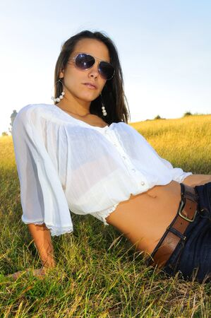 Portrait of young Fashion woman relaxing on the grass  photo