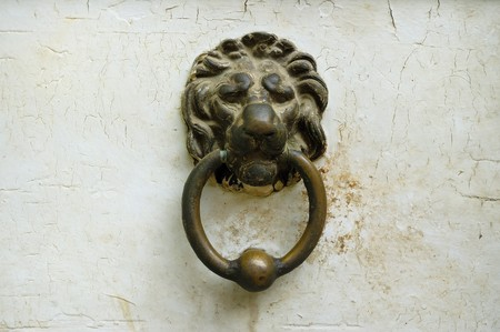 adornment: Vintage metal lion head doorbell adornment in old havana houses