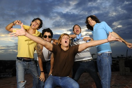 cool guy: Portrait of young trendy group of male friends having fun