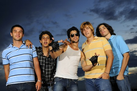 Portrait of young trendy group of friends standing with attitude Stock Photo - 4343558