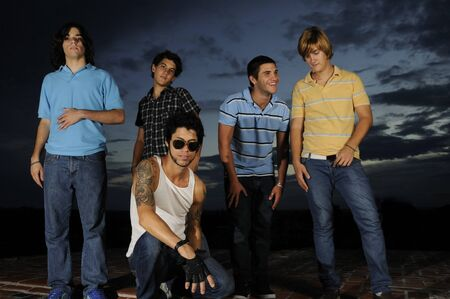 Portrait of young trendy group of friends standing with attitude Stock Photo - 4343569