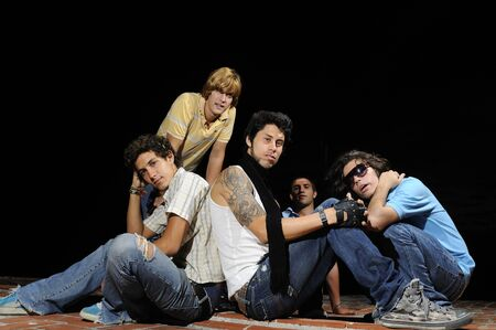 Portrait of young trendy group of friends posing with attitude Stock Photo - 4343568