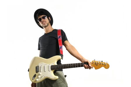 cool guy: Portrait of young cool man holding electric guitar isolated