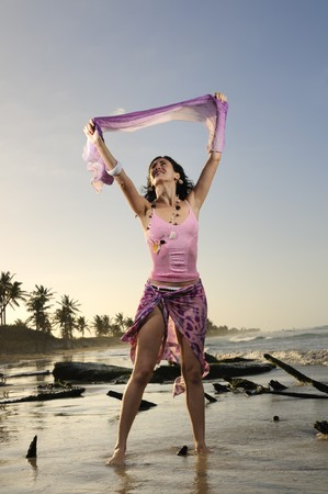 Portrait of young healthy woman enjoying the summer on the beach photo