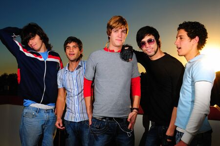 Portrait of young trendy group of friends standing together photo