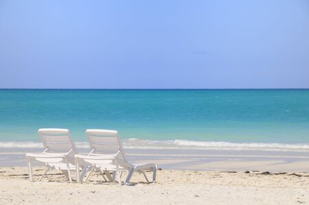 Two plastic chairs on tropical cuban beach, cayo guillermo Stok Fotoğraf