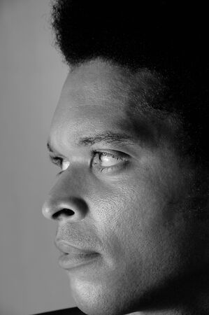 Profile portrait of young african american man in black and white photo
