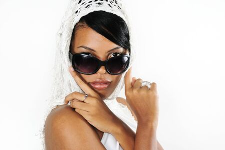 Portrait of young african american woman wearing sunglasses isolated photo