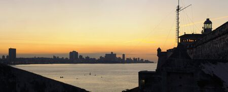A view of Havana bay and skyline at sunset from spanish fortress