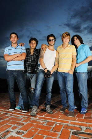 Portrait of young trendy group of friends standing with attitude photo