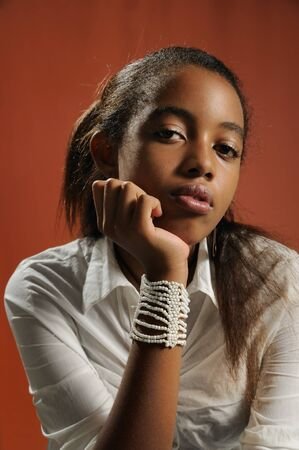 Portrait of young trendy african american teen girl posing with serious expression