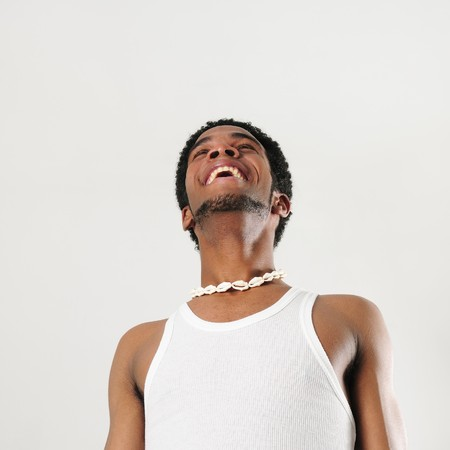 cool guy: Portrait of young african man with happy expression - isolated