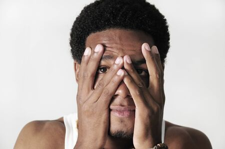 Portrait of young african american man with frustrated expression - isolated photo
