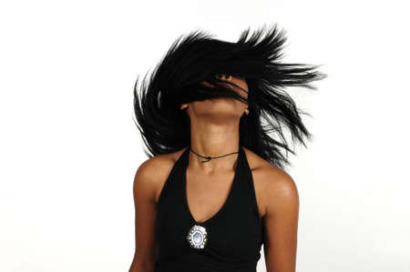 Portrait of young african woman waving her hair - isolated photo