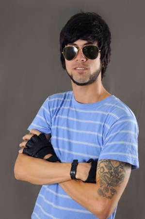 arm tattoo: Portrait of young trendy male with arm tattoo and sunglasses
