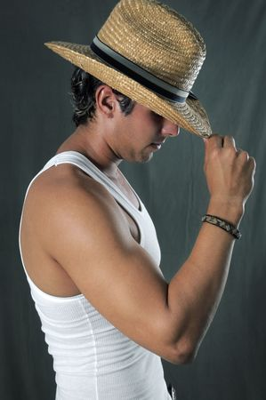 Portrait of young muscular man wearing hat Stock Photo