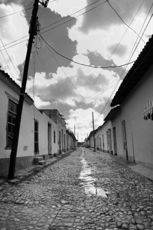 Black and white view of typical street in Trinidad town, cuba photo