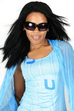 afro hairdo: Portrait of young african american female model wearing sunglasses isolated