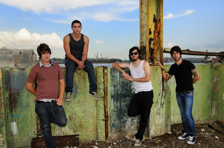 Portrait of casual team of friends posing on grunge urban scene photo
